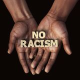 African hand with text No Racism. 3d illustration Stock Photos