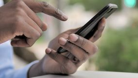 African Hand Using Smartphone. The African Hand Using Smartphone, high quality stock video footage