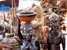 African handcraft dark wood carved figures Royalty Free Stock Image