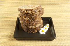 African handmade black soap with flowers Royalty Free Stock Photo