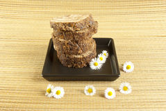 African handmade black soap with white flowers royalty free stock photos