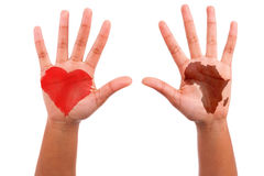 African hands with a painted heart and the african continent sha Stock Photography