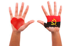 African hands with a painted heart and angolan flag, i love  ang Royalty Free Stock Photography