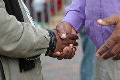 African hands shaking. Two African American men shaking their black hands as a sign of big friendship and to welcome Stock Photo