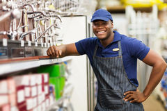 African hardware store worker. Portrait of cheerful african hardware store worker Royalty Free Stock Photos