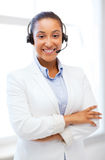 African helpline operator with headphones Royalty Free Stock Images