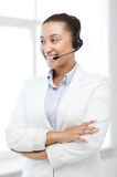 African helpline operator with headphones Royalty Free Stock Photo