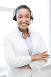 African helpline operator with headphones Royalty Free Stock Photos