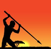 African hunter. Silhouette of Tribal African hunter on sunset background Stock Photography