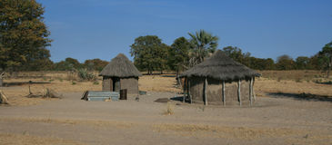 African hut. Many people in Africa live in shacks like this one. It's made of wood and clay and can be the home of more than one family Royalty Free Stock Photography