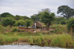 African Hut next to river Stock Photos