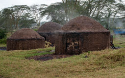 African hut for the production of charcoal Stock Image