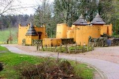 African huts in the Africa Museum, Berg en Dal, Groesbeek, Nijmegen, Netherlands. Primitive yellow African huts in the Africa Museum (Afrika Museum), Groesbeek Stock Photo