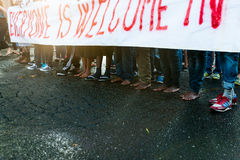 African immigrants march asking for hospitality for refugees Rome, Italy, 11 September 2015. Bare feet migrants at march at sunset stock images