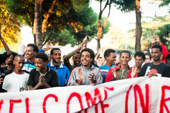 African immigrants march asking for hospitality for refugees Rome, Italy, 11 September 2015. Smiling migrants during march in favour of refugees stock images