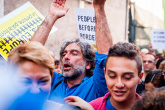 African immigrants march asking for hospitality for refugees Rome, Italy, 11 September 2015. White man marching with migrants at march in favour of refugees stock photos