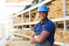 African industrial worker. Happy african industrial worker standing at building material warehouse Royalty Free Stock Photos