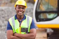 African industrial worker. Smiling african american industrial worker with arms crossed Royalty Free Stock Images