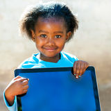African kid pointing at blank digital screen. Stock Photos