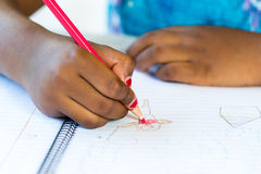 African kid's hand drawing on paper. royalty free stock photos