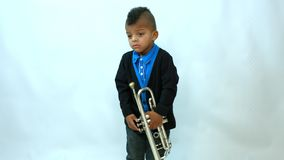 African kid and trumpet. African kid learning to play the trumpet stock video