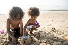 African kids enjoy playing together at the beach royalty free stock photography