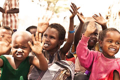 African kids with hands up. SAMBURU, KENYA - NOVEMBER 8: portrait of African group of kids with hands up on November 8, 2008 in tribal village near Samburu stock image