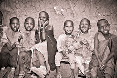 African Kids of Masai  tribe village are smiling, Tanzania. Royalty Free Stock Image
