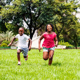 African kids running together in park. Stock Photo