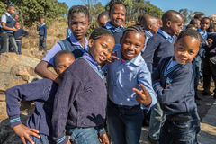 African kids. South African smiling boys and girls kids posing in school uniform royalty free stock images