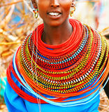 African lady. Portrait of a happy African lady wearing traditional handmade accessories stock image