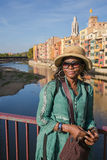 African Lady leaning on a bridge Stock Photo