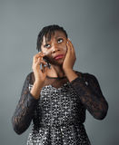 African lady looking sad whilst on a call. A portrait shot of an african lady receiving bad news on a phone call Stock Images