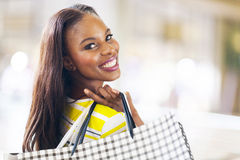 African lady shopping. Pretty african young lady shopping in mall royalty free stock images