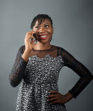 African lady smiling on a call stock images
