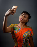 An african lady taking a selfie. A portrait shot of an african lady taking a selfie Stock Photo