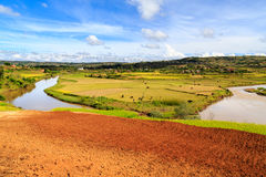 African landscape with river running through rice fields. And hills Stock Photo