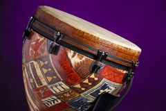 African Latin Djembe Drum on Purple Royalty Free Stock Photography