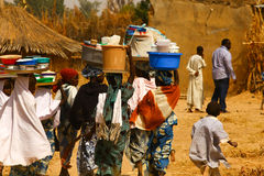 Africans Carrying Goods. Africans Fulani Origin Carrying Goods Wares on Heads Stock Photo