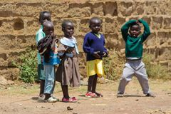 African little children play on a street. African little school children boys and girls play on the street in the small village school on a playground outside stock photography