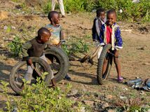 African little children playing with old moto wheels