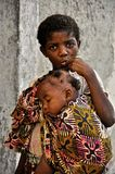 African little cute girl carrying baby brother Royalty Free Stock Image