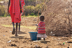 African little girl. Washes in her village Stock Photo