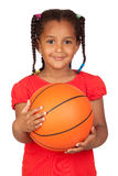 African little girl with a basket ball Royalty Free Stock Image