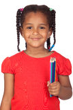 African little girl with crayons. Isolated on a over white Royalty Free Stock Image