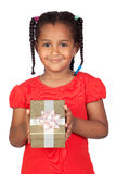 African little girl with a golden gift Royalty Free Stock Images