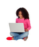 African little girl with a laptop. Isolated on a white background royalty free stock photos
