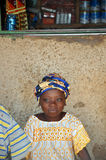 African little girl in a market. An African little girl sitting outside a shop in a market Royalty Free Stock Photos