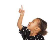 African little girl pointing her finger up Royalty Free Stock Photo