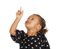 African little girl pointing her finger up. Isolated on white Royalty Free Stock Photography